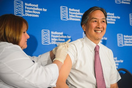 Dr. Koh gets himself vaccinated at the NFID Press Conference.  Photo courtesy of NFID.