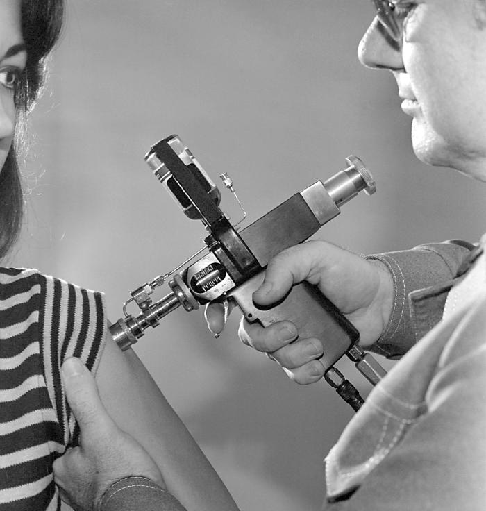 """Use of a jet injector during the 1976 New Jersey Influenza A immunization project in which 45 million adults in the United States received a vaccine containing the A/New Jersey/76 influenzavirus (""""swine flu"""" virus)."""